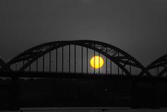 the setting sun (David Sebben) Tags: sunset centennial bridge quadcities selective color mississippi river