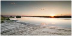 Along the St. Johns River. (Jill Bazeley) Tags: st saint johns river brevard county florida space coast bank shore sunset powerline high power line voltage