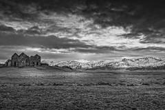 Abandoned Farm (Alan Amati) Tags: amati alanamati iceland icelandic abandoned farm landscape winter blackandwhite blackwhite bw monochrome field valley mountains ruins delapadated clouds dramatic hofn topf25 topf50 topf100