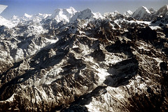 23-665 (nick dewolf photo archive) Tags: nepal snow mountains color film 35mm landscape view nick bluesky aerial 23 peaks 1970s himalayas fromtheair himalayan snowcovered mountainrange dewolf clearskies mountainpeaks himalayanrange fromtheairplanewindow nickdewolf photographbynickdewolf reel23