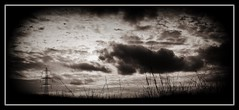 A Pylon Sky (Missy Jussy) Tags: sky bw monochrome grass clouds canon landscape mono blackwhite shadows pylons rochdale cannon600d