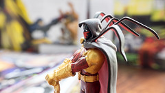 KL, MALAYSIA – OCTOBER 23, 2014: Slightly defocused and closeup figurine of  Azrael, a legacy of religious crusaders and vigilantes passed down since medieval times. (awiekupo) Tags: city blue man male celebrity standing buildings insect happy comic force power character beefy cartoon fame security health disguise hero superhero trust knight strong blade dccomics cheerful success crusader mantle protector medival azrael vigilante bluebeetle jaimereyes trainedassassin capecrusader bluebody plasmagun bluehero illustrativeeditorial swordofsalvation swordofsin bluefullbodysuit fullbofysuit