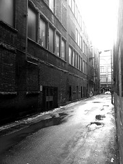 Alley Wall (Irrational Photography) Tags: montreal quebec canada digital photo picture samsung galaxy s ii 2 s2 sii samsunggalaxy android black white cellphone cell smartphone stcaths st ste catherine catherinescatherines stecatherine stecatherines catherines alley ally wet rain overblown sky puddle koala meatpie meat pie koalameatpie irrational photography