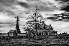A Home Forgotten (Inge Vautrin Photography) Tags: old sky bw house oklahoma home windmill clouds canon canoneos7d