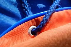 Orange and Blue (M. Carpentier) Tags: bleuorange bleu cordon macro macromondays oeillet orange vestedeflottaison orangeandblue