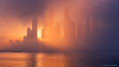 Peekaboo (...Kush...) Tags: dubai fog skyline dubaifog uae dubaimarina marina sunrise mist bay seascape morning palmjumeriah