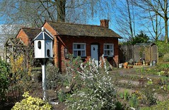 Country Cottage in Bridgemere Gardens (Eddie Crutchley) Tags: europe england cheshire outdoor gardens cottage blueskies sunlight simplysuperb greatphotographers