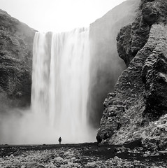 the scale of skógafoss (manyfires) Tags: hasselblad hasselblad500cm mediumformat square film analog iceland travel vacation waterfall skógafoss bw blackandwhite landscape europe