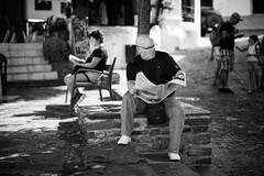 @1798 (saseki) Tags: leica bw espaa paper 50mm reading town spain pueblo calm andalucia bn granada summilux periodico lectura m9 capileira tranquilidad leyendo