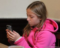 0212 (Marbeck53) Tags: portrait girl face female canon person eos hoodie kid child serious ky candid cellphone human blonde preteen covington greatniece 60d marbeck53 markriesenbeck