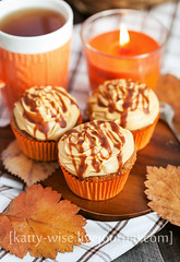 Carrot cupcakes with caramel cream cheese topping (Katty-S) Tags: thanksgiving autumn food orange fall cup coffee cake cheese dessert cozy candle tea sweet cream delicious caramel cupcake bakery carrot pastry mug treat baked decorated
