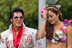 Elvis Headache (coqrico) Tags: woman girl festival lady female hawaii holding hand head elvis parade lei rico faux presley aloha headache phoney impersonator 2014 leffanta