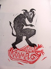 krampus on a bag of kids (craftyhag) Tags: christmas linocut rubberstamp darkart krampus
