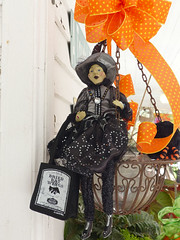 Witchy Woman (FagerstromFotos) Tags: orange black halloween nc batcave witch bow giftshop halloweendecorations atouchintime