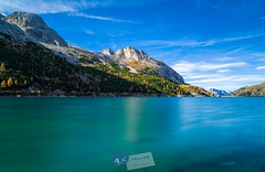 reservoir in the mountains… (A.K_Photography Hamburg) Tags: longexposure italien autumn sky italy sun mountains nature water colors clouds zeiss landscape lago lights see nationalpark nikon rocks wasser waterfront hiking plateau herbst pass wolken peak unesco berge autumncolors highland bergsee sonne unescoworldheritage trentino dolomites dolomiti südtirol haida marmolada naturpark langzeitbelichtung passo hochplateau dolomiten stausee staumauer fedaia marmolata neutraldensity d810 kalkalpen passhöhe passstrasse lagofedaia weltnaturerbe zf2 gebirgsmassiv nikond810 unescoworldnaturalheritage südlichekalkalpen fedaiapass trentinosüdtirol distagont2821 canazai fedaiastausee zeissdistagont2821zf2 unescoweltnaturerbedolomiten haidafilters haida18 provinzsüdtirol passofedaia2057m provinztrentino