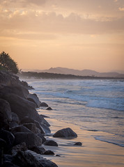 Belongil Beach @sunset (dlerps) Tags: ocean sunset sea orange cliff mountains reflection beach clouds sunrise evening sand surf waves stones sony sigma australia hills boulders newsouthwales byronbay goldenlight byronshire lerps sonyalphadslr sigma1850mmf28exdcmacro sonyalphaa77v daniellerps