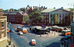 Harvard Square Cambridge MA (Edge and corner wear) Tags: street city our cambridge sign boston corner vintage campus square t pc university downtown track trolley postcard main harvard fair chrome wires mta newsstand overhead pantagraph