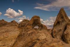 Eye of the rock (Fred Moore 1947) Tags: california clouds landscape rocks unitedstates explore highdesert lonepine easternsierra alabamahills