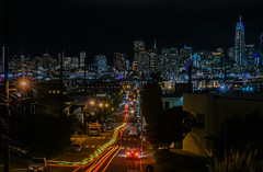 the metermaid army advances (pbo31) Tags: bayarea california nikon d810 color april 2017 spring boury pbo31 urban sanfrancisco city skyline night dark black potrerohill deharostreet lightstream motion traffic over view salesforce construction cranes infinity parkingenforcement metermaid victoriamews