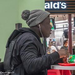 Burger King? (chromaphoto.co.uk) Tags: earphones burger mcdonalds hat listening milesaway eating