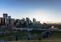 Big City Lights: Calgary Series 'A' (Image 1) (Martin Thielmann) Tags: ab bowriver centrestreetbridge memorialdrive sunsetbehindcalgaryskyline trafficonroads viewfromhillside