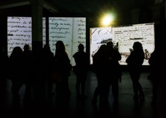 Silhouettes at an Art Gallery (john atte kiln) Tags: contemplating thinking vangogh vincentvangogh vincent women standing mesmerised painting impressionist handwriting sketches exhibition light lamp ploughing walls projection quote quotation