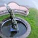 Scultura un corno-fontana; 1994. Bronzo, cm 200x60x60.<br /> Maglione, Via Cavour.
