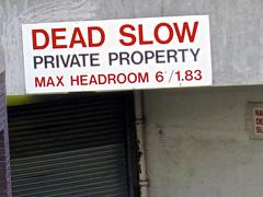 Dead Slow, London, UK (Robby Virus) Tags: city uk greatbritain england max london english sign danger warning private dead slow unitedkingdom britain garage entrance property caution british headroom maximum