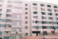 suburban haze (sophia liu / zszophia) Tags: travel light summer building film home 35mm rainbow haze apartment suburban pastel places olympus pale hong kong hues ethereal dreamy block colourful daze leaks
