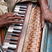 The hands of a musician in the streets of Kolkata, India.