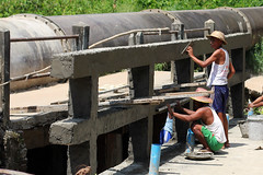 Children of the Yangon water pipe 44 (I.M.W.) Tags: myanmar burma yangon rangoon waterpipe water pipe rust iron steel waterpipeline pipeline watermain canon550d canon dslr 50mm canonef50mm114 bridge construction labour labor men hat concrete engineering asia people