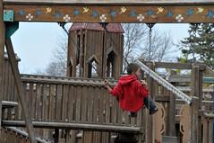 swinging high (Charlotte Clarke Geier) Tags: fall bicycle playground cormorant johndeere stormclouds monkeyisland menomineepark nikond300