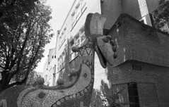 Imaginative Animal (Arne Kuilman) Tags: school blackandwhite film netherlands amsterdam animal nikon fuji mosaic nederland scan apx100 24mm dier zw fe2 mozak schoolgebouw hooftweg decorantijn