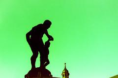 Ludo Mayer fountain/ Offenbach (Analog Aexel) Tags: ludomayerbrunnen crossed agfactprecisa100 canoneos300 precisa agfa xpro analog offenbach staue merkur silhouette crossprocess sun