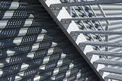 Stairway and shadow play (Jan van der Wolf) Tags: map14611v shadow schaduw monochrome monochroom stairs trap lines play shadowplay lijnenspel lijnen grey