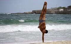 Acrobatics on the beach (alobos Life) Tags: guy playing jugando body beautiful agua arena beach boy brasil brazil brazilian candid copacabana cute de divertido enjoying janeiro mar outdoors playa praia rio sand sea speedo sunga water sony nex action accion man