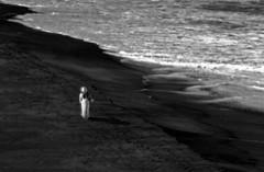 Detachment (coollessons2004) Tags: beach ocean kuaui hawaii woman white dress blackandwhite