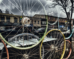 Wheels and reflections (GBaker63) Tags: toronto street window restaurant reflection bicycle rim canon powershots100