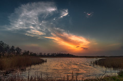 """Solar eruption"" (piotrekfil) Tags: nature landscape waterscape water lake sunset dusk twilight wind clouds sky sun pentax poland piotrfil"