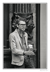 Coffee and a Cigarette (Seven_Wishes) Tags: newcastleupontyne photoborder outdoor jo cb jg canoneos5dmarkiv streetphotography candidphotography people smoker malesmoker coffee cigarette jacket jeans glasses bw mono monochrome blackandwhite toned starbucks dude cooldude portrait ejw