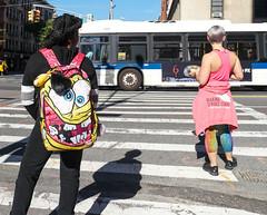 Crossing (UrbanphotoZ) Tags: women crossing back backpack bloodshot dizzy rottingteeth tshirt sweat leggings makingstridestoheal lunch stevemadden centralpark2012 bus 6 fx w79st amsterdamave upperwestside manhattan newyorkcity newyork nyc ny