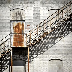 Fire Escape Shadows (tim.perdue) Tags: fire escape shadows rust door rusty rusted stairs steps metal steel brick wall white peeling paint bricked up window urban decay industrial warehouse building sunlight shadow contrast abandoned empty deserted neglected ruin vacant