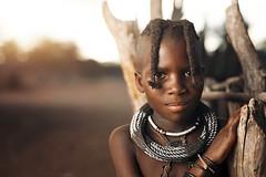 By the kraal (Sean Tucker Photo) Tags: himba thehimba namibia paulcbuff photeksoftlighterii alienbee800 canon5dmkii canon sigma50mmart sigma50mmf14 tribe africa kamanjab onelight strobist travel travelphotography travelportrait portrait portraitphotography