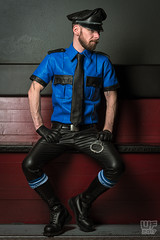Tom in Blue Leather (WF portraits) Tags: aut male model onlocation man portrait leather blueleather black blackleather tie boots cap shirt gloves handcuffs tomoffinland beard gaybeard fetish gayfetish gayleather gayotter