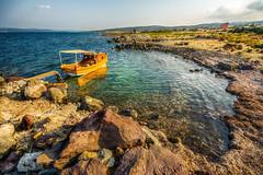 A bay (Nejdet Duzen) Tags: trip travel sea reflection yellow turkey boat trkiye rocky deniz sandal sar yansma turkei seyahat kayalk izmirglbahe