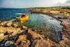 A bay (Nejdet Duzen) Tags: trip travel sea reflection yellow turkey boat türkiye rocky deniz sandal sarı yansıma turkei seyahat kayalık izmirgülbahçe