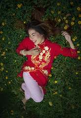 Happy (Fevzi DINTAS) Tags: portrait people cute girl beautiful smile field fashion lady pose relax asian thailand happy pretty vietnamese moody modeling outdoor traditional style human national enjoy geographic cultural laydown flowars paza140