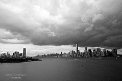 (King Kiaan) Tags: cloud newyork storm building tower monochrome freedom state manhattan district empire jersey hudson financial