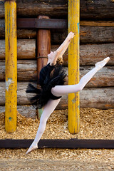 Jen 34 (LongInt57) Tags: blue girls people ballet woman brown white motion black industry yellow nude person women industrial dancers dancing action modeling models logs teens tights blonde modelling slippers leaping tutu sawmill woodchips sawdust