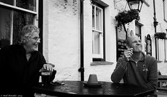 Don't let the rain get in your beer. (Neil. Moralee) Tags: street old uk blackandwhite bw white house man black men public beer monochrome smile st fruit bar garden outside happy mono pub nikon cornwall flavor cigarette candid seat smoke drinking ale neil mature tavern charlestown british tribute frown smoker pint raining carefree bitter drinkers flavour hops austell malt tangy intherain 18300mm d7100 moralee neilmoralee nikon18300mmd7100neilmoralee